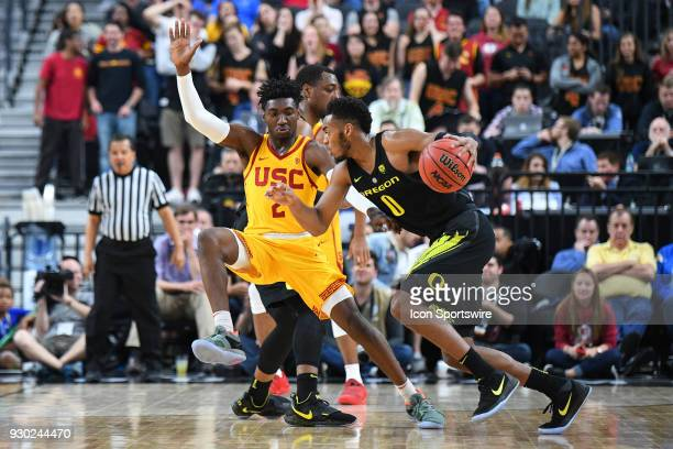 USC guard Jonah Mathews defends Oregon forward Troy Brown during the semifinal game of the mens Pac12 Tournament between the Oregon Ducks and the USC...