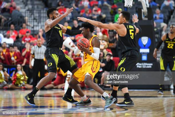 USC guard Jonah Mathews is trapped by Oregon forward Troy Brown and Oregon guard Elijah Brown during the semifinal game of the mens Pac12 Tournament...