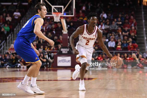 USC guard Jonah Mathews sets up the offense during a college basketball game between the UC Santa Barbara Gauchos and the USC Trojans on November 26...