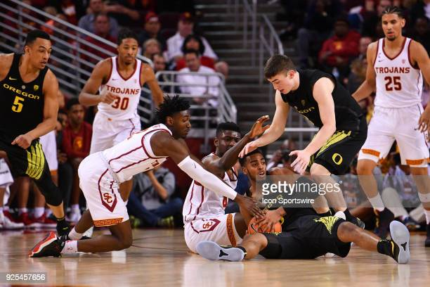 USC guard Jonah Mathews USC forward Chimezie Metu Oregon forward Troy Brown and Oregon guard Payton Pritchard fight for a loose ball during a college...