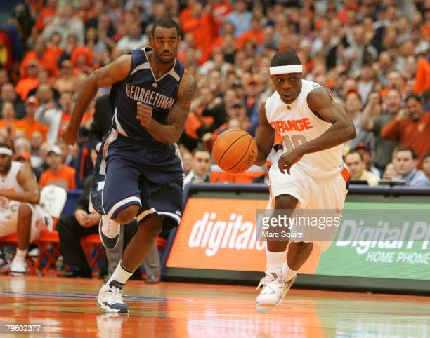 Guard Jonny Flynn of the Syracuse Orange drives past Forward Dajuan Summers of the Georgetown Hoyas during the game at the Carrier Dome February 16...