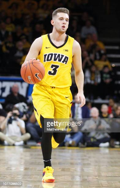 Guard Jordan Bohannon of the Iowa Hawkeyes brings the ball down the court in the first half against the Wisconsin Badgers on November 30 2018 at...