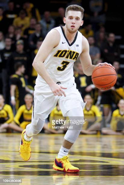 Guard Jordan Bohannon of the Iowa Hawkeyes brings the ball down the court in the second half against the Ohio State Buckeyes on January 12 2019 at...