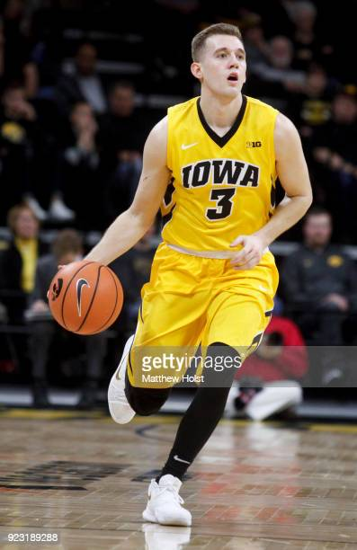 Guard Jordan Bohannon of the Iowa Hawkeyes brings the ball down the court during the first half against the Indiana Hoosiers on February 17 2018 at...