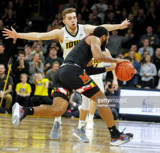 Guard Jordan Bohannon of the Iowa Hawkeyes defends in the second half against guard Eric Ayala of the Maryland Terrapins on February 19 2019 at...