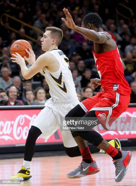 Guard Jordan Bohannon of the Iowa Hawkeyes drives against guard Kam Williams of the Ohio State Buckeyes in the second half on January 28 2017 at...