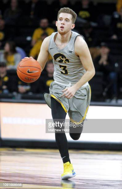 Guard Jordan Bohannon of the Iowa Hawkeyes drives down the court in the second half against the Nebraska Cornhusker on January 6 2019 at...