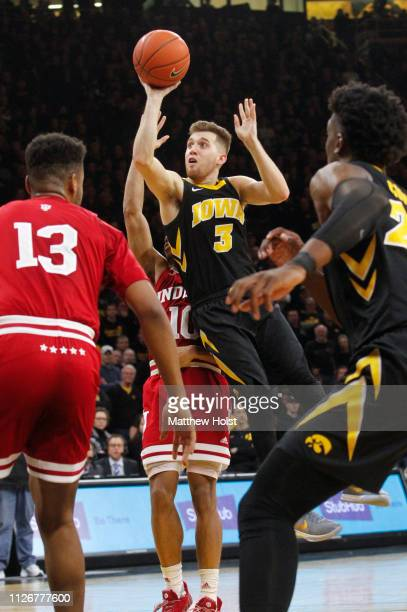 Guard Jordan Bohannon of the Iowa Hawkeyes takes a shot inovertime against guard Rob Phinisee of the Indiana Hoosiers on February 22 2019 at...