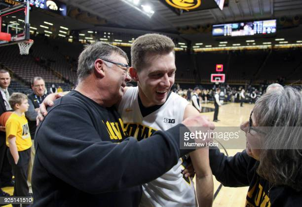 Guard Jordan Bohannon of the Iowa Hawkeyes visits with Mike and Patty Street following the matchup against the Northwestern Wildcats on February 25...