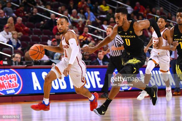 USC guard Jordan McLaughlin drives by Oregon forward Troy Brown during a college basketball game between the Oregon Ducks and the USC Trojans on...