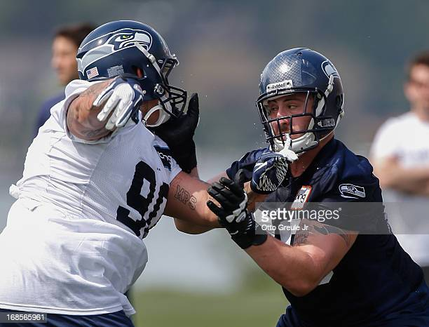 Guard Jordon Roussos of the Seattle Seahawks pass blocks against defensive tackle Jesse Williams during Rookie Camp at the Virginia Mason Athletic...