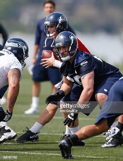 Guard Jordon Roussos of the Seattle Seahawks pass blocks as quarterback Jake Mullin drops back to pass during Rookie Camp at the Virginia Mason...