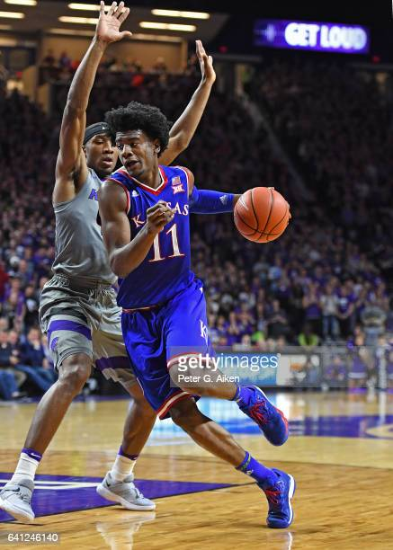 Guard Josh Jackson of the Kansas Jayhawks drives around guard Xavier Sneed of the Kansas State Wildcats during the first half on February 6, 2017 at...