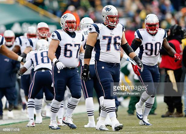 Guard Josh Kline and tackle Sebastian Vollmer of the New England Patriots during the NFL game against the Green Bay Packers at Lambeau Field on...