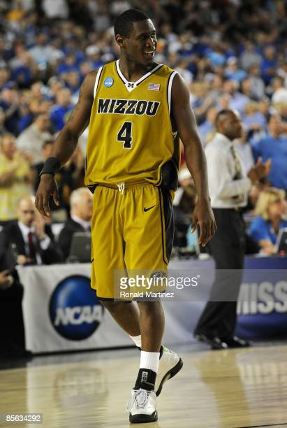 Guard J.T. Tiller of the Missouri Tigers walks off the court after defeating the Memphis Tigers 102-91 in the Sweet 16 of the NCAA Division I Men's...