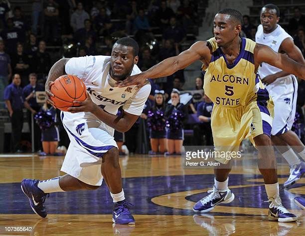 Guard Juevol Myles of the Kansas State Wildcats grabs a loose ball away from guard Marquiz Baker of the Alcorn State Braves during the second half on...