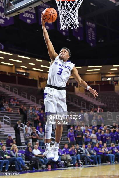 Guard Kamau Stokes of the Kansas State Wildcats drives in for a basket against the Northern Arizona Lumberjacks during the second half on November 20...