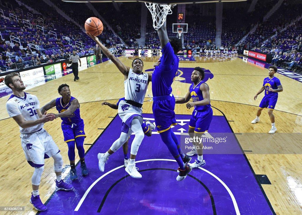 Guard Kamau Stokes #3 of the Kansas State Wildcats drives to the basket against the Missouri-Kansas City Kangaroos during the first half on November 14, 2017 at Bramlage Coliseum in Manhattan, Kansas.