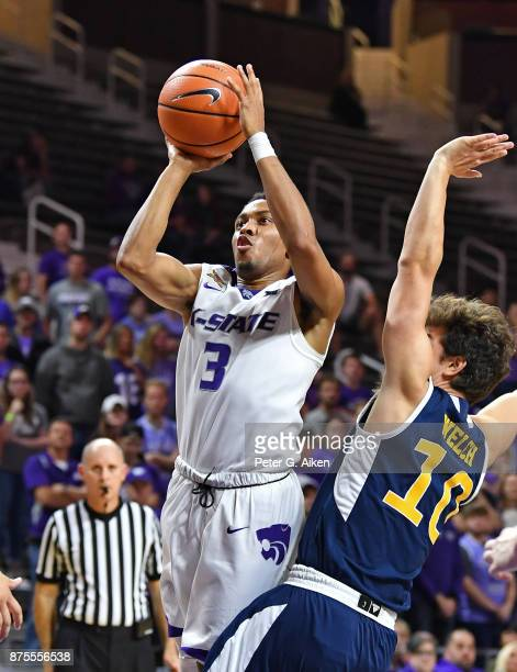 Guard Kamau Stokes of the Kansas State Wildcats shoots the ball against guard Riley Welch of the CaliforniaIrvine Anteaters during the second half on...