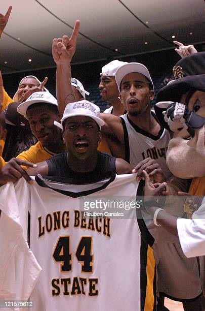 Guard Kejuan Johnson and forward Dominique Ricks of the Long Beach State 49ers celebrate after a 94 to 83 win over the Cal Poly Mustangs in the...