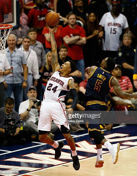 Guard Kent Bazemore of the Atlanta Hawks shoots behind guard JR Smith of the Cleveland Cavaliers during Game One of the Eastern Conference Finals...