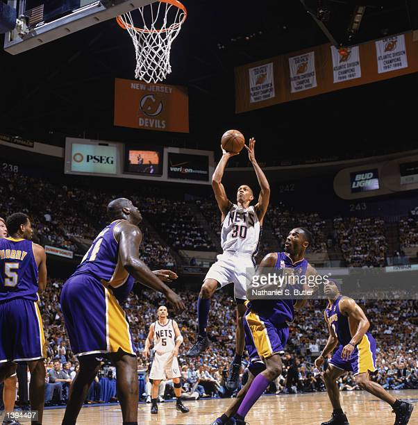 Guard Kerry Kittles of the New Jersey Nets shoots over center Shaquille O'Neal and guard Kobe Bryant of the Los Angeles Lakers during Game Four of...