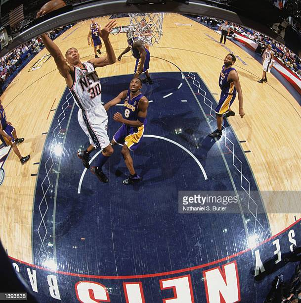 Guard Kerry Kittles of the New Jersey Nets shoots past guard Kobe Bryant of the Los Angeles Lakers during Game Four of the 2002 NBA Finals at...
