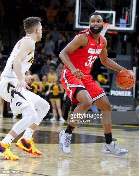 Guard Keshawn Woods of the Ohio State Buckeyes drives down the court in the first half against guard Jordan Bohannon of the Iowa Hawkeyes on January...