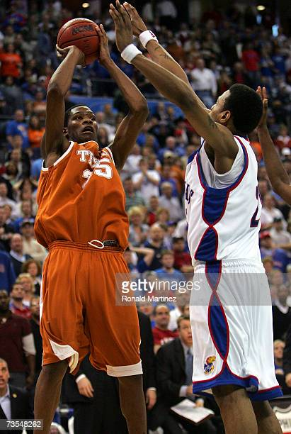 caea2ca6dec Guard Kevin Durant of the Texas Longhorns takes a shot against Brandon Rush  of the Kansas