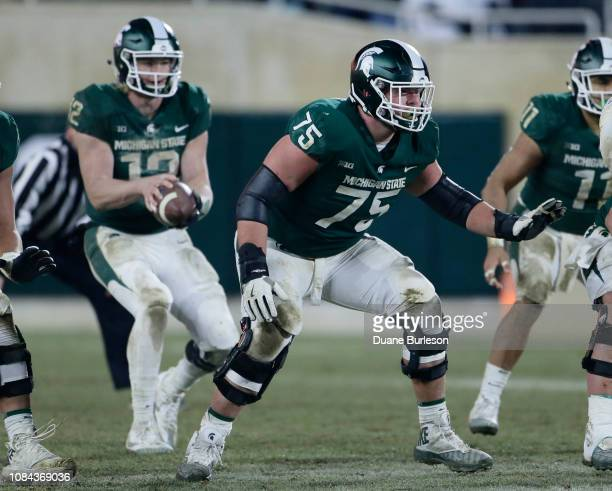 Guard Kevin Jarvis of the Michigan State Spartans protects quarterback Rocky Lombardi of the Michigan State Spartans during the second half of a game...