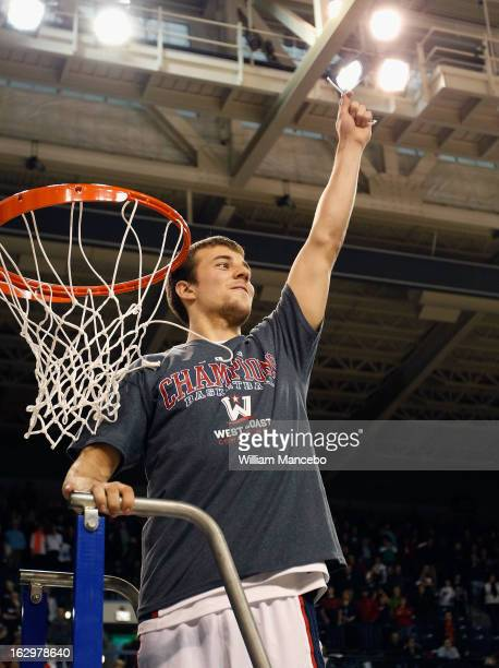 Guard Kevin Pangos of the Gonzaga Bulldogs cuts off a piece of the net as the Bulldogs take the 2013 WCC Championship title after defeating the...