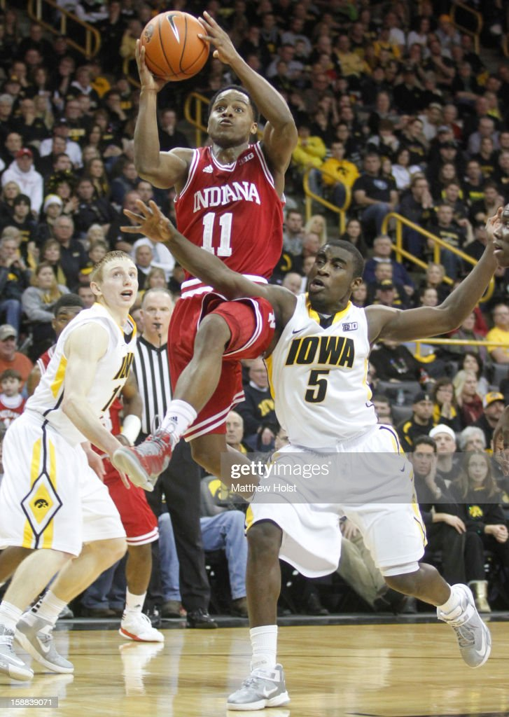 Guard Kevin 'Yogi' Ferrell of the Indiana Hoosiers drives to the basket during the first half against guard Anthony Clemmons #5 of the Iowa Hawkeyes on December 31, 2012 at Carver-Hawkeye Arena in Iowa City, Iowa. Indiana won 69-65.