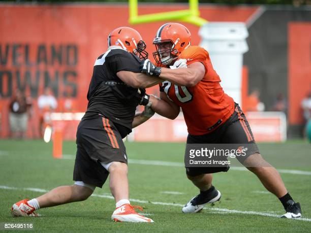 Guard Kevin Zeitler and defensive lineman Jamie Meder of the Cleveland Browns engage during a training camp practice on August 2 2017 at the...