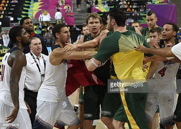 US guard Klay Thompson argues with a Lithuanian player at the end of the 2014 FIBA World basketball championships semifinal match Lithuania vs USA at...