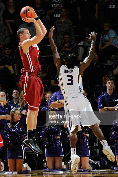 Guard Klay Thompson of the Washington State Cougars puts up a shot over pressure from guard Martavious Irving of the Kansas State Wildcats in the...