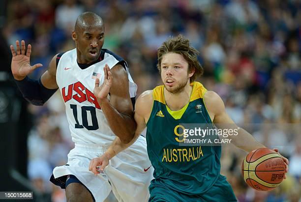 Guard Kobe Bryant challenges Australian guard Matt Dellavedova during their London 2012 Olympic Games men's quarterfinal basketball match in London...