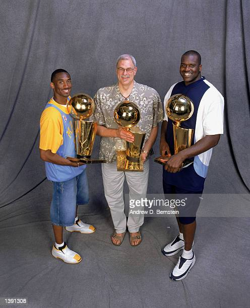 Guard Kobe Bryant head coach Phil Jackson and center Shaquille O'Neal of the Los Angeles Lakers pose for a studio portrait with their three...
