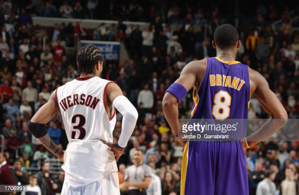 Guard Kobe Bryant of the Los Angeles Lakers and guard Allen Iverson of the Philadelphia 76ers puts their hands on their hips as they watch the play...