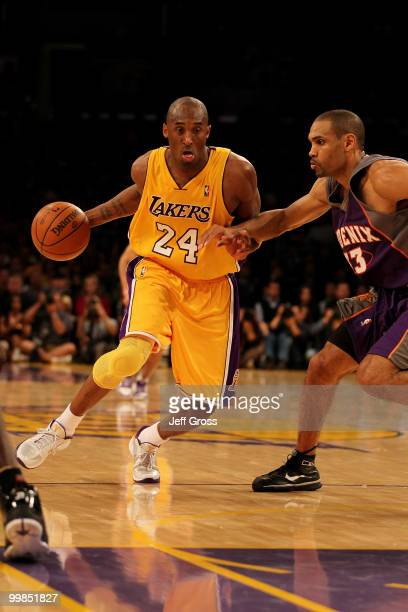 Guard Kobe Bryant of the Los Angeles Lakers drives with the ball against the Phoenix Suns in Game One of the Western Conference Finals during the...