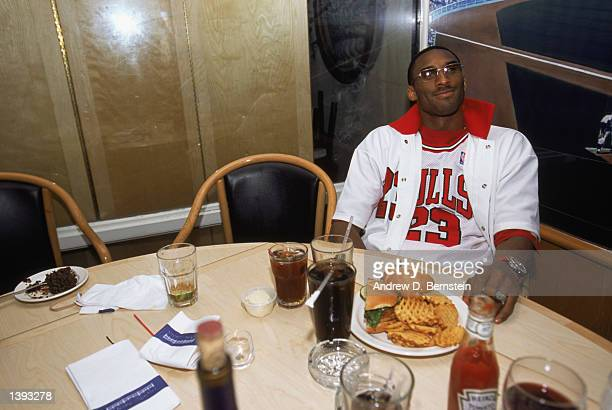 Guard Kobe Bryant of the Los Angeles Lakers eats a hamburger as his pregame meal before Game Four of the 2002 NBA Finals against the New Jersey Nets...