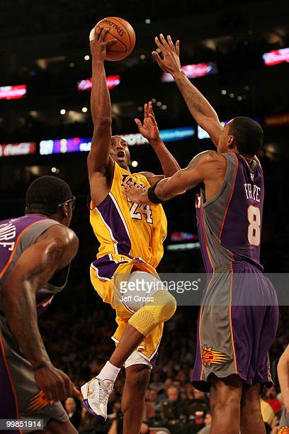 Guard Kobe Bryant of the Los Angeles Lakers goes up for a shot against Channing Frye of the Phoenix Suns in Game One of the Western Conference Finals...
