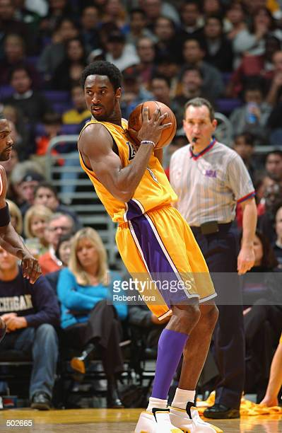 Guard Kobe Bryant of the Los Angeles Lakers holds the ball during the NBA game against the Houston Rockets at Staples Center in Los Angeles,...