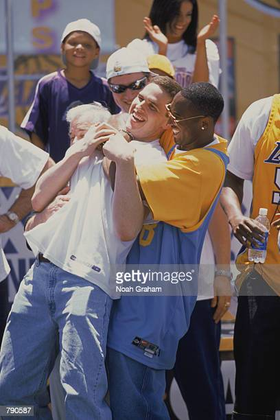 Guard Kobe Bryant of the Los Angeles Lakers hugs forward Mark Madsen during the Lakers championship victory rally in Los Angeles, California on June...