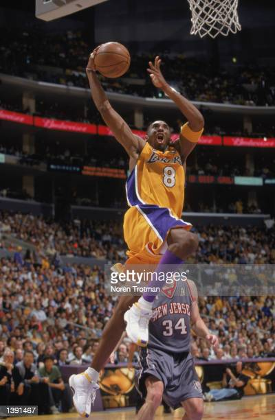 Guard Kobe Bryant of the Los Angeles Lakers soars to the basket during Game Two of the 2002 NBA Finals against the New Jersey Nets at Staples Center...
