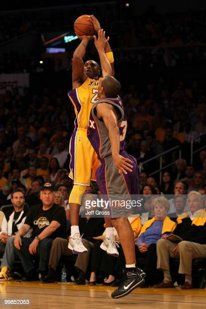 Guard Kobe Bryant of the Los Angeles Lakers takes a shot against Grant Hill of the Phoenix Suns in Game One of the Western Conference Finals during...