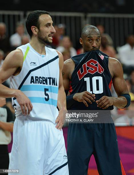 US guard Kobe Bryant stands by Argentinian guard Emanuel Ginobili during the men's basketball preliminary round match Argentina vs USA as part of the...