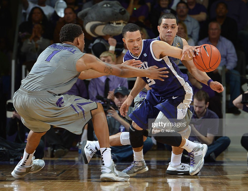 Guard Kyan Anderson #5 of the Texas Christian Horned Frogs dribbles against pressure from guards Angel Rodriguez #13 and Shane Southwell #1 of the Kansas State Wildcats during the second half on March 5, 2013 at Bramlage Coliseum in Manhattan, Kansas. Kansas State defeated Texas Christian 79-68.