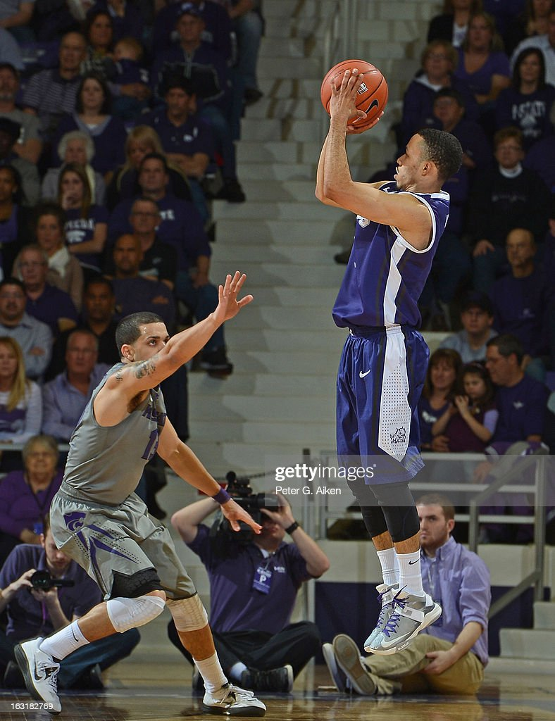 Guard Kyan Anderson #5 of the Texas Christian Horned Frogs hits a three-point shot over guard Angel Rodriguez #13 of the Kansas State Wildcats during the second half on March 5, 2013 at Bramlage Coliseum in Manhattan, Kansas. Kansas State defeated Texas Christian 79-68.