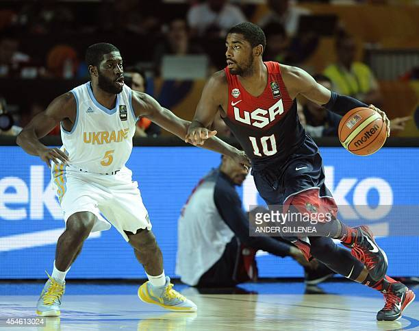 US guard Kyrie Irving vies with Ukraine's guard Eugene 'Pooh' Jeter during the 2014 FIBA World basketball championships group C match Ukraine vs USA...