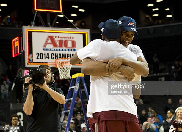 Guard Langston Galloway and forward Ronald Roberts of Saint Joseph's Hawks hug one another after defeating the VCU Rams in the Championship game of...